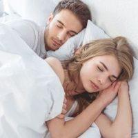 sleeping-couple-anti-snoring-pillow.jpg